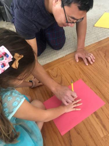 If you are making a large wall or door Thankfulness Tree, tape the brown trunk paper up and then tape the hand print leaves coming off the top of the trunk.
